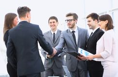 Welcome and handshake of business partners on the briefing. Handshake of business partners on the briefing Stock Image