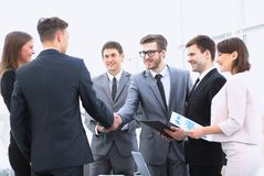 Welcome and handshake of business partners on the briefing. Handshake of business partners on the briefing Royalty Free Stock Images