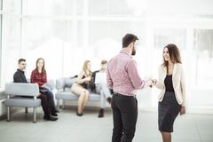 Welcome and handshake of business partners in the lobby of the office. The photo has a empty space for your text Stock Images