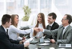 Welcome handshake of business partners at the negotiating table stock image