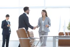 Welcome handshake Manager and the client. Photo with copy space stock photography