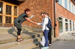 Welcome handshake in new school Royalty Free Stock Image