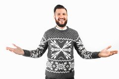 Welcome. Handsome young man with a beard, gestures and smiles stock image