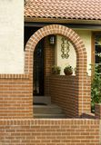 Welcome Home. A red tiled roof on a stucco home with arched entry welcomes you home.  Blank address placard lets you place words or numbers to personalize Stock Image