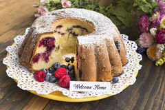 Welcome Home Card with Kugelhopf and Flowers Royalty Free Stock Photos