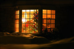 Welcome Home Christmas Tree in Window Royalty Free Stock Images