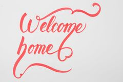 Welcome Home creative brush lettering on white background with copy space. Welcome Home creative brush lettering on white background with copy space Royalty Free Stock Photography