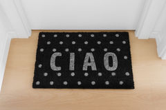 Welcome home doormat with close door Stock Photos