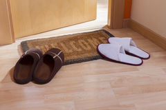 Welcome home doormat with open door Royalty Free Stock Images