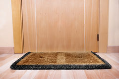 Welcome home doormat with open door Royalty Free Stock Photo