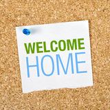 Welcome Home. Message on Reminder Paper pinned to a Cork Memory Board royalty free stock photography