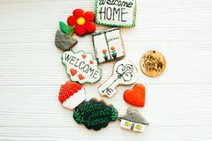 Welcome home set. Delicious key, house, plant,window,heart and welcome sign cookies on white wood, flat lay with space for text. Dream home concept. Home Sweet stock photography