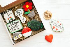 Welcome home set. Delicious key, house, plant,window,heart and welcome sign cookies on white wood, flat lay with space for text. Dream home concept. Home Sweet royalty free stock photo