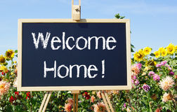 Welcome home sign and flowers Royalty Free Stock Images