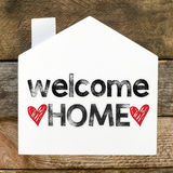 Welcome Home sign. On rustic wood royalty free stock photo