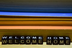 Welcome home written on wooden blocks. Education and business concept stock image