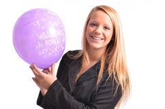 Welcome home. Young woman holding a balloon on isolated white background royalty free stock photo