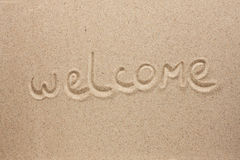 Welcome is the inscription by hand on the sand Stock Image