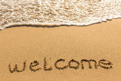 Welcome - inscription on sand beach Royalty Free Stock Photo