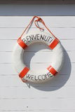 Welcome in Italy. Rubber ring on white beach hut Stock Photo
