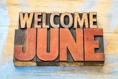 Welcome June in letterpress wood type Royalty Free Stock Image