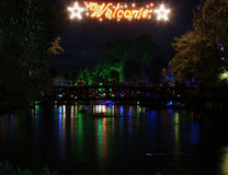 Welcome Lake. A welcome sign over a bridge on a small lake in New Plymouth, New Zealand. The lighting in this town is an annual event, and well worth a visit royalty free stock photography