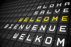 Welcome in languages on black mechanical board Royalty Free Stock Image