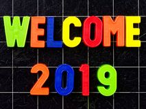 Welcome 2019 Magnetic colorful letters blackboard or chalkboard. Welcome 2019 Magnetic colorful letters on blackboard or chalkboard Stock Images