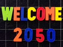 Welcome 2050 Magnetic colorful letters on blackboard chalkboard Royalty Free Stock Images