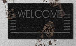 Welcome Mat. With mud footprints Royalty Free Stock Photos