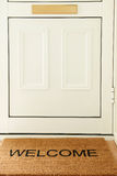 Welcome Mat In Front Of Door To Home Stock Photography