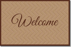 Welcome mat. Isolated rustic wicker welcoming mat with shadow Royalty Free Stock Images