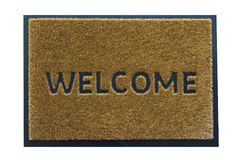 Welcome mat isolated on white background. Welcome brown doormat isolated on white background, with welcome sign on it Royalty Free Stock Photo