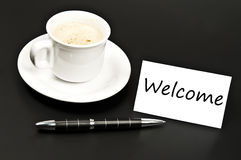 Welcome message on desk with coffee Stock Photography
