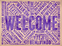 Welcome. Message in many different languages written with ink on paper as background Stock Images