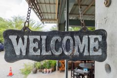 """""""welcome"""" metal label and old style, vintage tone Royalty Free Stock Photography"""