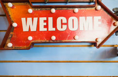 """""""welcome"""" metal red label and old style, vintage tone Stock Photo"""