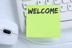 Welcome new employee colleague refugees refugee immigrants computer business concept mouse. Desk keyboard royalty free stock photo