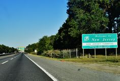 Welcome new jersey sign usa road. There is Welcome to New Jersey state road sign in USA, the state, which is next to more famous state as New York. For travelers Royalty Free Stock Images