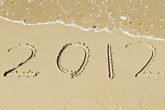 The welcome of the new year 2012. Message in the sand at the beach near the ocean Stock Images