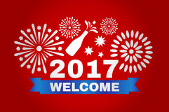 Welcome new year 2017. Inscription and fireworks on a red background Royalty Free Stock Images