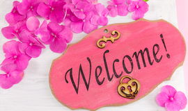 Welcome note on the wooden frame Royalty Free Stock Photography