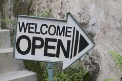 Welcome / Open arrow sign stock photos