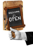 Welcome it is Open - Sign with Hand of Waiter Royalty Free Stock Image