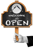 Welcome it is Open - Sign with Hand of Waiter Stock Photo