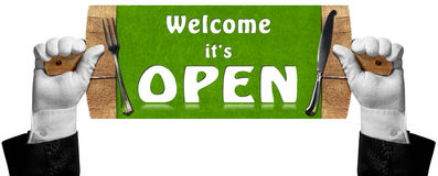 Welcome it is Open - Sign with Hands of Waiter Stock Photos