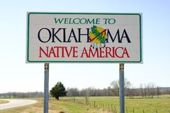 Welcome to Oklahoma Sign, Native America. Welcome ot Oklahoma Sign on a sunny blue sky day Stock Photos