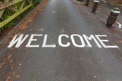 Welcome painted on driveway entrance Royalty Free Stock Photography