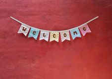 Welcome party flag design on red cement wall texture background. Design vintage style welcome party flag on red texture background Royalty Free Stock Photography
