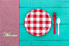 Welcome picnic setting sign on blue wood background Stock Photography
